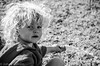 A day in the grass (EdholmFoto) Tags: child black white bw beautiful blonde curlyhair water grass portrait