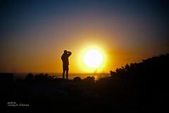 Learning (Oddiseis) Tags: sun sunset silhouette formentera balearicislands spain contrast backlighting colors people me david family portrait photographer cliffs sunglare sky