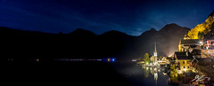 Two Lovers Walk A Lakeside Mile (TVZ Photography) Tags: panorama panoramic hallstatt gmunden salzkammergut austria hallstättersee europe lake water reflection mountains sky stars town village houses night evening longexposure sony a7r voigtlander 21mm ultron