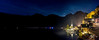 Two Lovers Walk A Lakeside Mile (Tim van Zundert) Tags: panorama panoramic hallstatt gmunden salzkammergut austria hallstättersee europe lake water reflection mountains sky stars town village houses night evening longexposure sony a7r voigtlander 21mm ultron