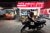 Evening Life in Saraphi, Chiang Mai, Thailand (jonasfj) Tags: nikond750 tamronsp153028vc ultrawideangle wide 15mm saraphi chiangmai thailand asia southeastasia foodstand motorcycle evening dark darkness fluorescentlights dinner food