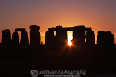 Sun setting between the iconic Stonehenge. 10/11/10 Low res photo to prevent copying. (waynebutton661) Tags: sun iconic stonehenge 101110 england stones heritage wiltshire