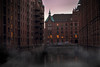 Mist (ItalianCandy) Tags: hamburg canal water buildings altstadt old town ddr photomanipulation editing photoshop vanishing pathway speicherstadt hafencity sunset fog mist lights road cars bridge