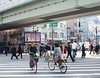 A Crosswalk in Osaka (thedailyjaw) Tags: osaka japan d610 nikon biking cycling bicycle crosswalk walking people city japanesepeople bridge movement