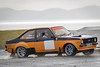 Chris Berry & Heather Merrison (Howie Mudge LRPS BPE1*) Tags: ford rally car orange black motor vehicle sport sports sportsphotography fast action movement anglesey tracmon circuit race track racer racing canon canon7dmkii sigma simga150600c wet rain raining mountains road tarmac