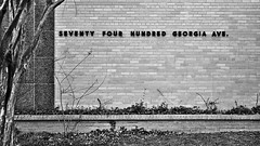 seventyfourhundred (dr_scholz@ymail.com) Tags: georgiaave outdoors architecture nature wall lines straightlines tree grass vegetation blackwhite letters brick leicam240 summicron35mmf2asph summicronm