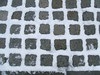Snow on the cobbles. (Bennydorm) Tags: blanc white grid squares february europe uk gb britain cumbria furness ulverston roadside pavement fujifinepix form shapes patterns cobbles cobblestones cold winter snow