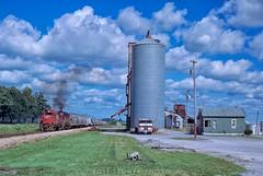 Earl Park, Indiana (rolfstumpf) Tags: usa indiana earlpark kbs alco rs3 rs20 railway railroad trains freight rural grain elevator grass yard peterbilt truck sky clouds blue green fujichrome mamiya kbs308 kbs324
