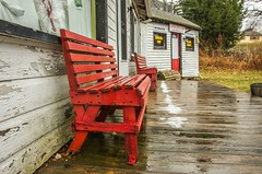 Waiting for Summer (Bud in Wells, Maine) Tags: wells bench harborroad rain maine buildings weathered red spring