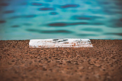 Focus (darrinwalden Photography) Tags: sharp focus soft lane 2 swim race sport water pebbles