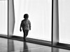Little Boy Walking (d_t_vos) Tags: boy child littleboy walk walking play playing light contrast backpack monochrome lines glass curtain lacecurtain netcurtain smile grill grille grating kunsthal museum rotterdam zeedijk museumpark dickvos dtvos