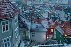 Bergen Wakes Up (RomImage) Tags: bergen snow winter wintertime wakeup morning cold freeze freezing town city europe north northern northeurope tourism travel urban lowlight nocturne night snowcity light house woodenhouses nikon d800 ice icy building houses far pier nobody lighton roof roofs mood atmosphere tiny tinyhouse colourful bluehour snowing tiles