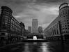 London in symmetry (singulartalent) Tags: canarywharf uk blackandwhite cabothouse citigroup fountain london markhigham monochrome rain