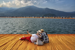the floating piers (Roberto.Trombetta) Tags: italy italia iseo lago lake water franciacorta monte isola passerella floating pier christo crowd people walking acqua montagne mountain orange arancione sony 7rii alpha batis225 batis zeiss 25 carlzeiss art fineart amazing stunning beautiful landscape land artist montisola sulzano paesaggio barefoot shoeless summer estate peschiera maraglio sensole san paolo brescia lombardia jeanne claude projects jeanneclaude 7rm2 allaperto cielo bagnasciuga litorale selfie mobile tourist couple romantic lovers easy like sunday morning