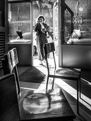 Looking for a Cold Brew (tritranla) Tags: california contrast starbucks candid street woman losangeles cafe shadow people melrose