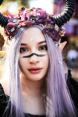 Wide-eyed Innocence (wyojones) Tags: texan texas texasrenaissancefestival toodmission trf festival faire renaissance pinkhair girl woman beautiful beauty browneyes horn facepaint pretty cute lovely star flowers