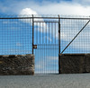 01 Gate (reshoot) (manxmaid2000) Tags: gate fence sky clouds high closed nowhere locked wire security safety barb barbed spike post lock wall madeira abstract lines sunshine diagonal nothing beyond unusual secure height angle perspective square