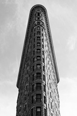 New York City | Flatiron Building 02 (Christopher James Botham) Tags: nyc new york city newyork newyorkcity manhattan cityscape street streetscape urban flatiron building architecture historic burnham danielburnham skyscraper tower mono black white grey blackandwhite road people sky monochrome
