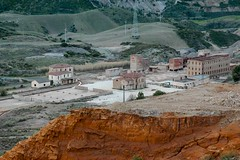 Sardinia (Andrea Manconi (Rubagalline)) Tags: italy sardinia abandoned mine village green grass mountains red gravel industrial wasted postnuclear factory concrete