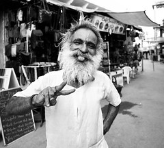 Happy Sadhu (solas53) Tags: sadhu happy holy man street portrait india pushkar blackwhite blackandwhite bw black white monochrome people tongue beard