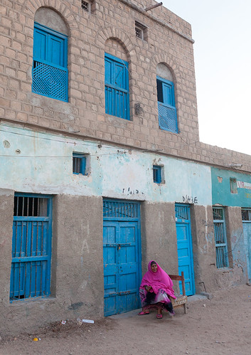 Somali woman in front of a former ottoman empire house, North-Western province, Berbera, Somaliland