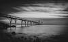 Clevedon... (Jess Feldon) Tags: longexposure pier clevedon somerset severnestuary severn victorianpier blackandwhite monochrome coast moody dark rocks jessfeldon sky clouds