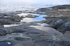 Softened by the sea and ice (liisatuulia) Tags: bylandet porkkala puddles water reflection kallio rock sea