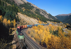 First section of No. 15 (Moffat Road) Tags: burlingtonnorthernsantafe bnsf burlingtonnorthern bn mariaspass java montana autumn fallcolor emd sd402 hiline mariaspassroute 6850 stack stacktrain intermodal 15 mt glaciernationalpark snowshed