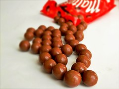 Chocolate (Clare-White) Tags: smileonsaturdays roundandround malteesers sweets chocolate red food dof yummy