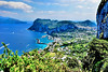 Capri (Geoff Henson) Tags: italy capris sea harbour boats hills clouds rocks cliffs water ocean vista trees houses buildings
