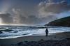 Mesmerised (suerowlands2013) Tags: portwrinkle secornwall stormclouds waves beach cliffs eveninglight lonefigure silhouette winter heavyseas