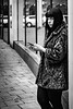 The Look (Kieron Ellis) Tags: street blackandwhite blackwhite monochrome woman smoking ring phone fur reflection