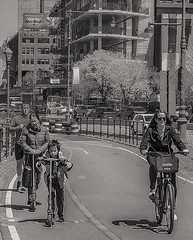 """Candid of People On Bike and Running Path Getting Some Spring Excercise (nrhodesphotos(the_eye_of_the_moment)) Tags: p42101903001084 """"theeyeofthemoment21gmailcom"""" """"wwwflickrcomphotostheeyeofthemoment"""" manhattan nyc chelsea bikers outdoors blackandwhite men women children scooter running bikeandrunningpath buildings skyward construction roadway shadow metal reflections windows westside bikes"""