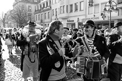 Kölle Alaaf! (gambajo) Tags: 1year1town1lens brühl blackandwhite blackwhite black white street streetphotography karneval carnival fun public people men disguise music musicans walk x100s fujix100s fujifilmx100s