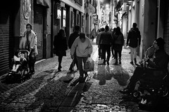 2 chairs and an old man (rvjak) Tags: séville sevilla d750 nikon spain espagne black noir blanc white bw street rue night nuit saxophone musicien musician wheel push chair mom mother baby girl old vieux