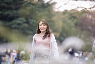 Young woman walking in public park
