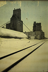 Along the Tracks, Butterfield, Minnesota, April, 2018 (Dave Linscheid) Tags: railroad spring winter snow elevator grainelevator texture textured agriculture quonset architecture