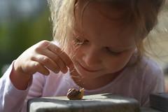 Little girl and snail. (agnieszka.a.morawska) Tags: smile littlegirl girl portrait nature bokeh beyondbokeh bokehlicious bkhq helios44m helios happy snail childhood child