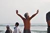 Salute to the sun (Roving I) Tags: elderly aged exercise saluetothesun tourists sea surf horizon beaches barechests gestures poses yoga danang vietnam lifestyle