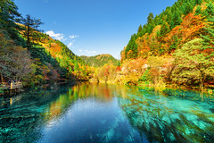 Colorful autumn forest reflected in the Five Flower Lake (www.layerplay.design) Tags: