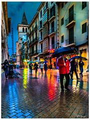 Rainy evening in San Miguel street (Bruno Frerejean) Tags: streetphotos palmademallorca people gente men lluvia pluie rain parapluies reflets reflejos reflections nightshot nightofpalma fotocallejera noche night