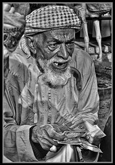 """The Camel Trader"" (flavius200) Tags: panosonic gx1 wilfred thesiger desolate isolated uae 4x4 camping alone traveller exploring tribes david harford flavius200 dorking photocraft camera club fishing woman bedu bedouin arabia desert sand scrub mountain mono monochrome black white nikon d200 d3x"