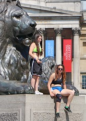 Sporty Girls (Waterford_Man) Tags: girls shorts fit bare midriff midrift london candid people tourists mobile phone