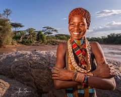 Young Hamer Woman at the Keske river crossing (Turmi, Ethiopia 2014) (Alex Stoen) Tags: 1dx africa african alexstoen alexstoenphotography canon canoneos1dx creativelighting culture ef1635f28liiusm ethiopia geotagged girl hamer happiness keskeriver natgeo nationalgeographicexpeditions omovalley portrait retrato sonrisa tradition travel tribes turmi vacation woman offshoeflash smile