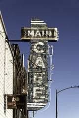 Main Cafe (unknown quantity) Tags: neonsign fadedpaint shadows streetlight rust fadedlettering sky oxidation weathered deterioration peelingpaint decay