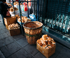 sunday morning, la paz (almostsummersky) Tags: bag vendor street bolivia city southamerica bread stall morning sabbatical urban sidewalk sunday basket lapaz box pan