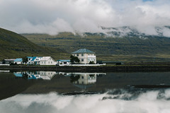 Houses by the Fjord (desomnis) Tags: iceland island travel traveling landscape water reflection fjord seydisfjordur eastfjords easticeland europe europa travelphotography landschaft landscapes waterreflection clouds cloudysky cloudy mountains mountainandclouds mountain houses desomnis 5d canon5dmarkiv canon5d tamronsp2470mmf28 tamron2470mm tamron2470mmf28 tamron2470 tamron canon