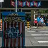 More Popcorn (prima seadiva) Tags: belltown cinerama crosswalk dog hydrant movie people sign theater red blue street