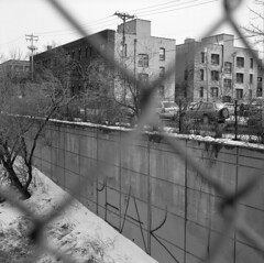 peak (kaumpphoto) Tags: rolleiflex 120 tlr bw black white street urban city peak cement tree car wire telephonepole snow slope angle fence chainlink window graffiti building apartment concrete wall rectangle block tire architecture infrastructure spray paint gray minneapolis
