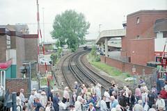 EMU approaching Poole Level Crossing, June 2006 (Ian D Nolan) Tags: poolestation railway 35mm epsonperfectionv750scanner